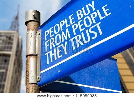 People Buy From People They Trust written on road sign