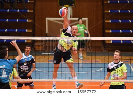 KAPOSVAR, HUNGARY - JANUARY 16: Zoltan David (with ball) in action at a Hungarian National Championship volleyball game Kaposvar (green) vs. Sumeg (blue), January 16, 2016 in Kaposvar, Hungary.