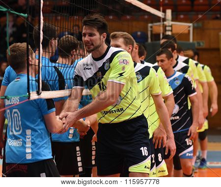 KAPOSVAR, HUNGARY - JANUARY 16: Competitors shake hand before a Hungarian National Championship volleyball game Kaposvar (green) vs. Sumeg (blue), January 16, 2016 in Kaposvar, Hungary.
