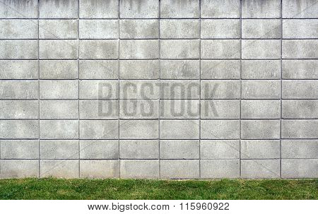 Concrete Block Wall Background With Grass