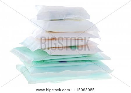 A pile of different types and sizes of Sanitary napkins (sanitary towel, sanitary pad, menstrual pad) isolated on white