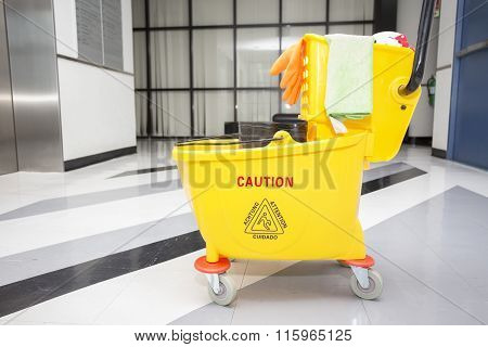 Yellow Mop Bucket And Set Of Cleaning Equipment In The Office