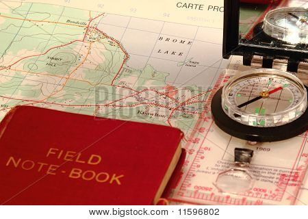 Compass On Map With Book