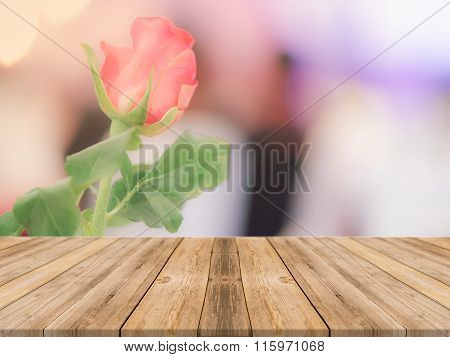 Wooden Board Empty Table blur beautiful roses - can be used for display or montage.