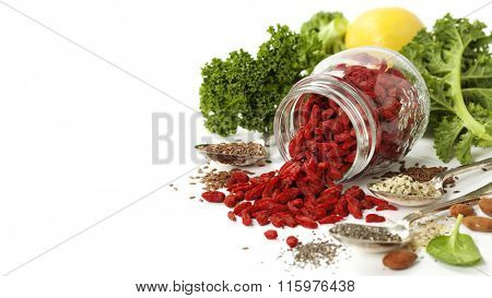 Various superfoods on white background. Healthy food, diet, vegetarian or clean eating concept. Background layout with free text space.