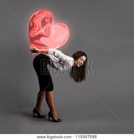 Woman is bending over under heavy heart symbol