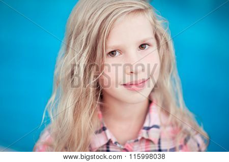 Smiling kid girl over blue