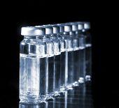Glass Medicine Vials botox and hyaluronic collagen or flu syringe. Tinted image. poster
