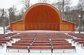the straw-hat theatre emptu in winter with trees background poster