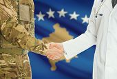 Soldier in uniform and doctor shaking hands with national flag on background - Kosovo poster