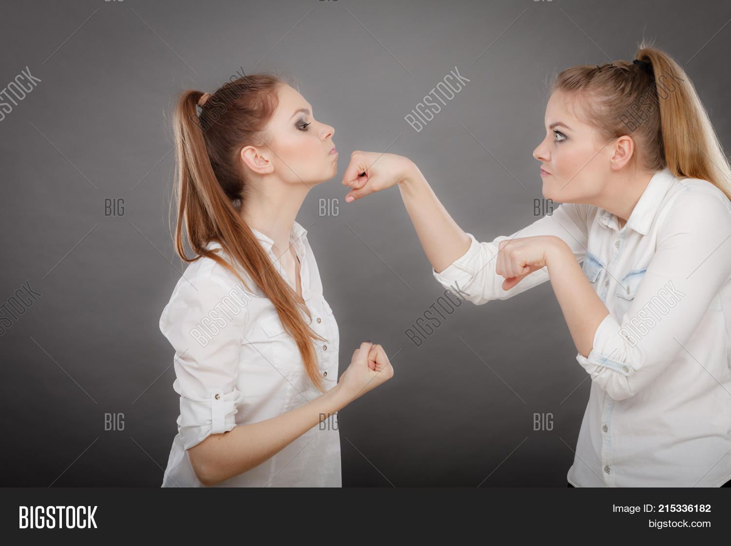Two women playing with each other