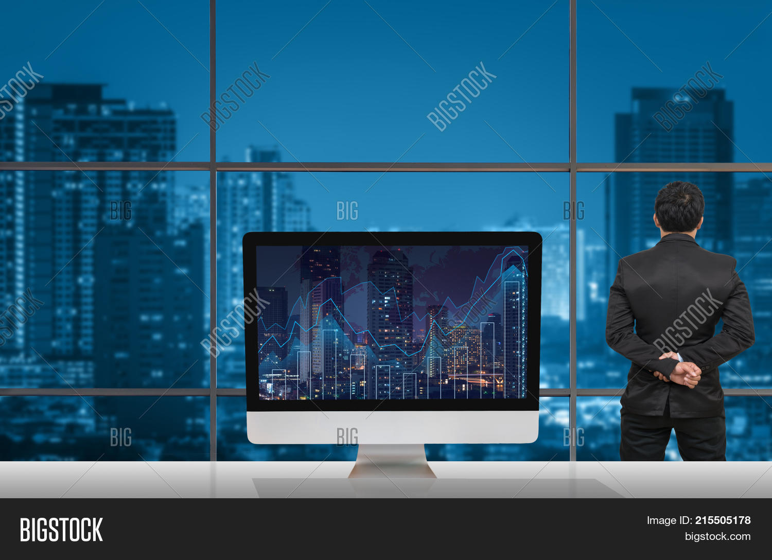 Back side businessman image photo free trial bigstock back side of businessman looking at citiy out off windows glass with computer show trading graph gumiabroncs Gallery