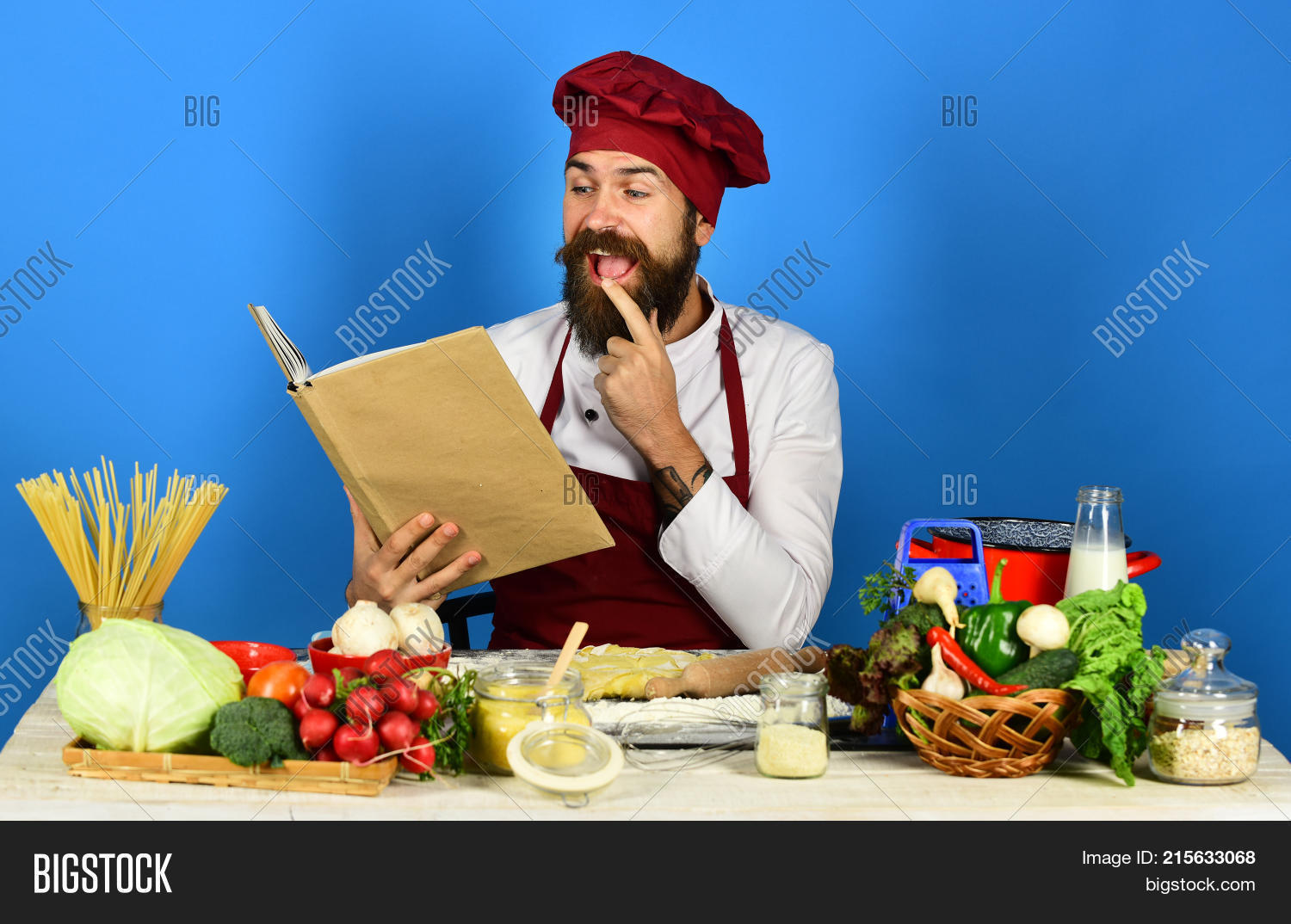 Man beard holds recipe image photo free trial bigstock man with beard holds recipe book or menu on blue forumfinder Gallery
