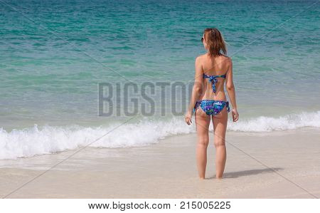 Young girl in the blue sea at PhuketThailand