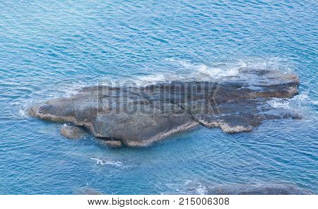 Rock on the blue sea at Phuket ,Thailand