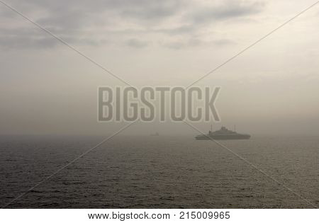 Meeting ferry in the mist at a Norwegian fjord. Some fog, mist on the North Sea.