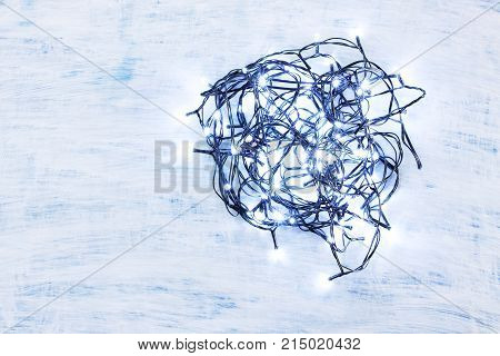 Christmas Fairy Lights on a Wooden Background