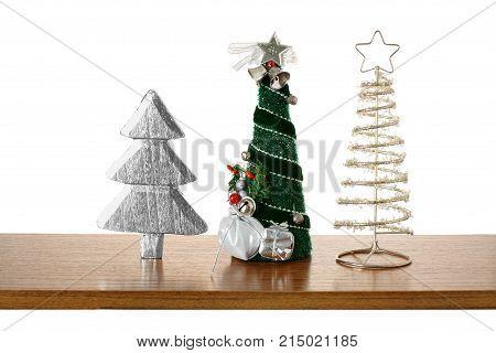 Miniature Christmas Decorations on a Wooden Shelf