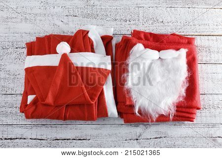 Santa Clause Costume on a Wooden Background