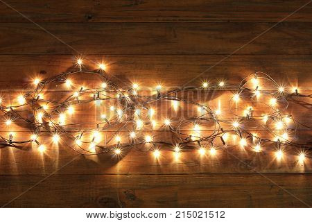 Fairy Lights on Wooden Background with Copyspace