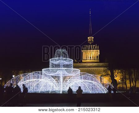 fountain from the shining fires on the square in front of the Admiralty on New Year's Eve. St. Petersburg. Russia