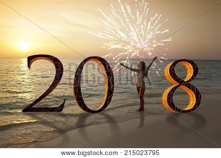 Happy new year card 2018. Silhouette of young woman on the beach stand as a part of the Number 2018 sign