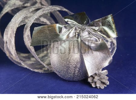 beautiful silvery New Year's ball brilliant tinsel aon a blue background - New Year's composition a card