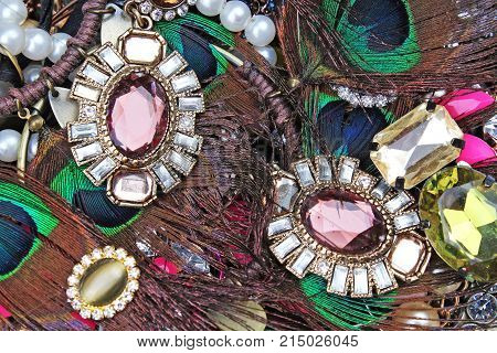 Fashion jewelrys. Fashion jewels as background. Jewelery texture. A lot of Jewells in texture. Jewellery background. Beautiful jewels pattern. Necklace earrings bracelet. Studio photo texture photography. Texture background.
