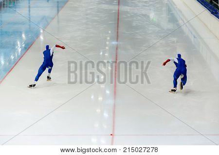 back start athletes speed skater of speed skating competition
