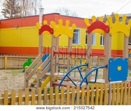 Colorful Children's Playground In The Sun, A Playhouse And A Slide