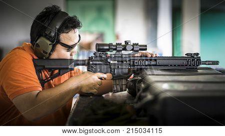 Man shooting on shooting range, selective focus