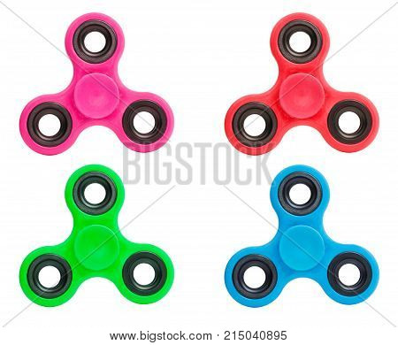 Blue pink green red spinners stress relieving toy isolated on white background