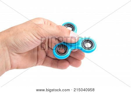 Hands of child  twist blue spinner stress relieving toy isolated on white background