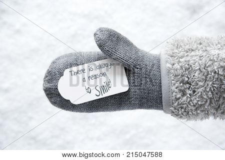 Wool Glove With Label With English Quote There Is Always A Reason To Smile. White Snow Background.