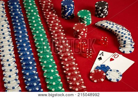 Two cards and chips on a red background. Big bet of game money. Cards - Ace and Ten. Your distribution at the table. Casino background. Copy space. Still life. poster