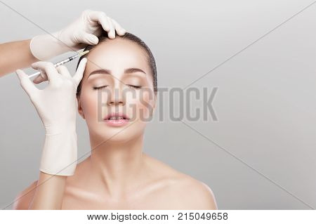 Needle mesotherapy. Cosmetic been injected in woman's head. strengthen the hair and their growth poster