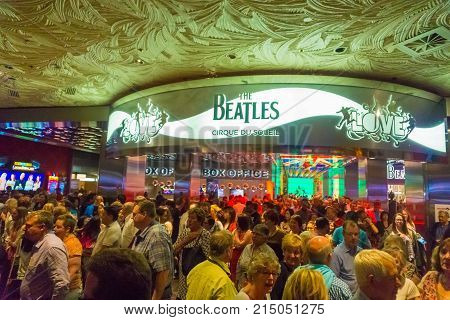 Las Vegas, United States of America - May 06, 2016: The people going near entrance to The Beatles Cirque du Soleil Theater Love Show at The Mirage hotel at Las Vegas, United States of America on May 06, 2016