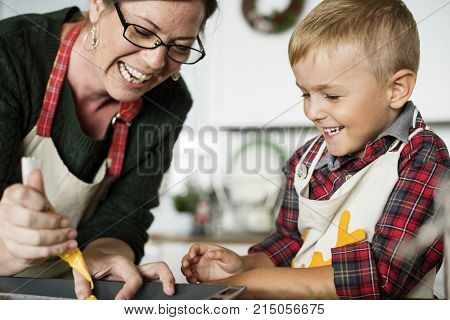 Mother and son having fun in the kitchen