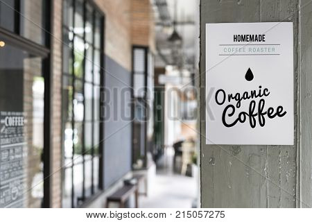 Organic coffee advertisement on a wall