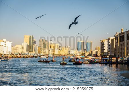Dubai, UAE, February 5, 2016: Abras ferrying tourists and locals across Dubai Creek