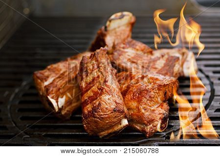 beef short ribs on bbq flame grill
