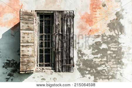 old window on house gazed with cobwebs