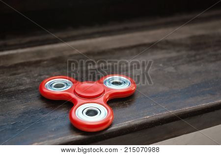 Fidget Spinner On A Wooden Surface. Stress Relieving Toy