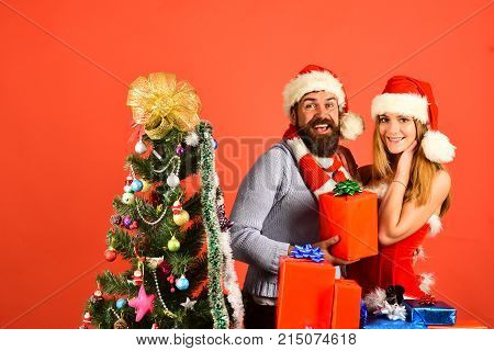 Christmas Gifts And Love Concept. Santa And Sexy Girl