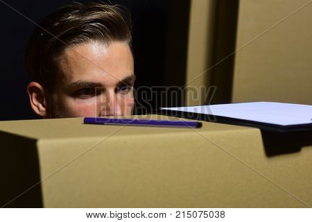 Sexuality And Moving Concept. Deliveryman Looks Close On Boxes.