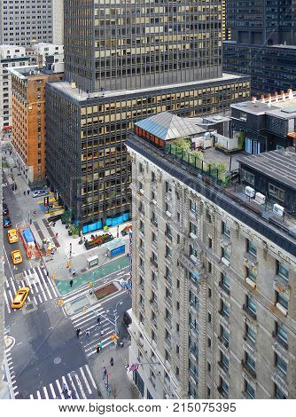 NEW YORK CITY, MANHATTAN, SEP,12, 2014: NYC sky scrapers buildings hotels and people on streets. NYC buildings business offices roofs. Aerial view on New York streets yellow taxi cars. NYC streets