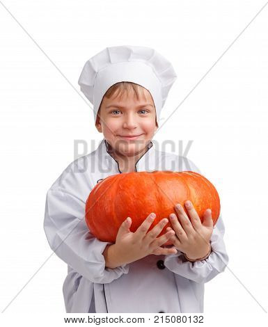 Little cook in a cap with a nice smile holding a pumpkin on a white isolated background
