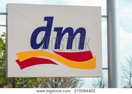 HUETTENBERG GERMANY MAY 2017: DM drugstore chain sign. DM is a german global drugstore discount supermarket chain based in Karlsruhe Baden-Wuerttemberg Germany