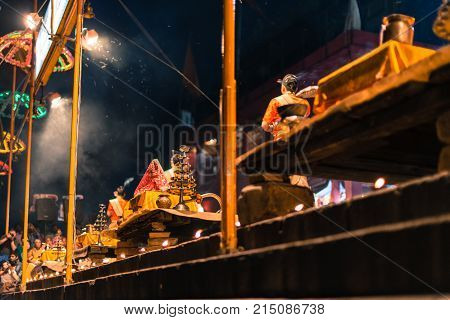 VARANASI INDIA - MARCH 14 2016: Horizontal picture of ornated candle on the table at religious Ganga Aarti ritual at Dashashwamedh Ghat in Varanasi India.