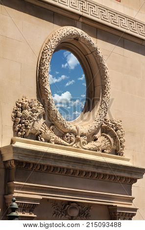 Nice Sky Reflected in Ornate Round Window